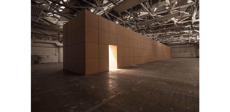 <em>318 prepared dc-motors, cork balls, cardboard boxes, 100x100x100cm</em>