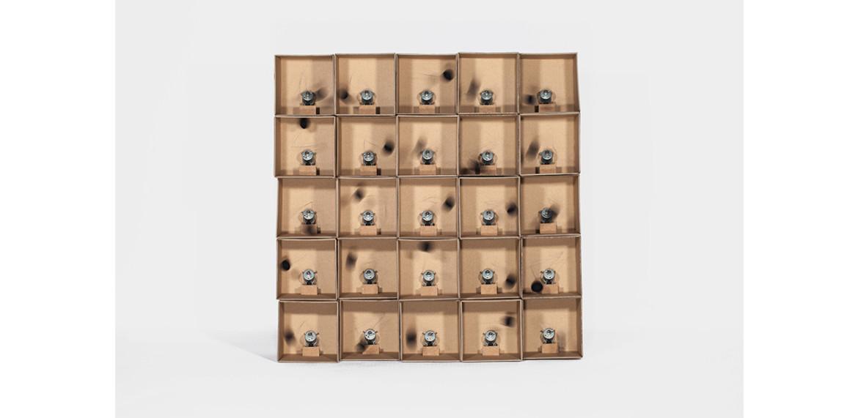 <em>25 prepared dc-motors, felt balls, cardboard boxes 13x13x13cm</em>